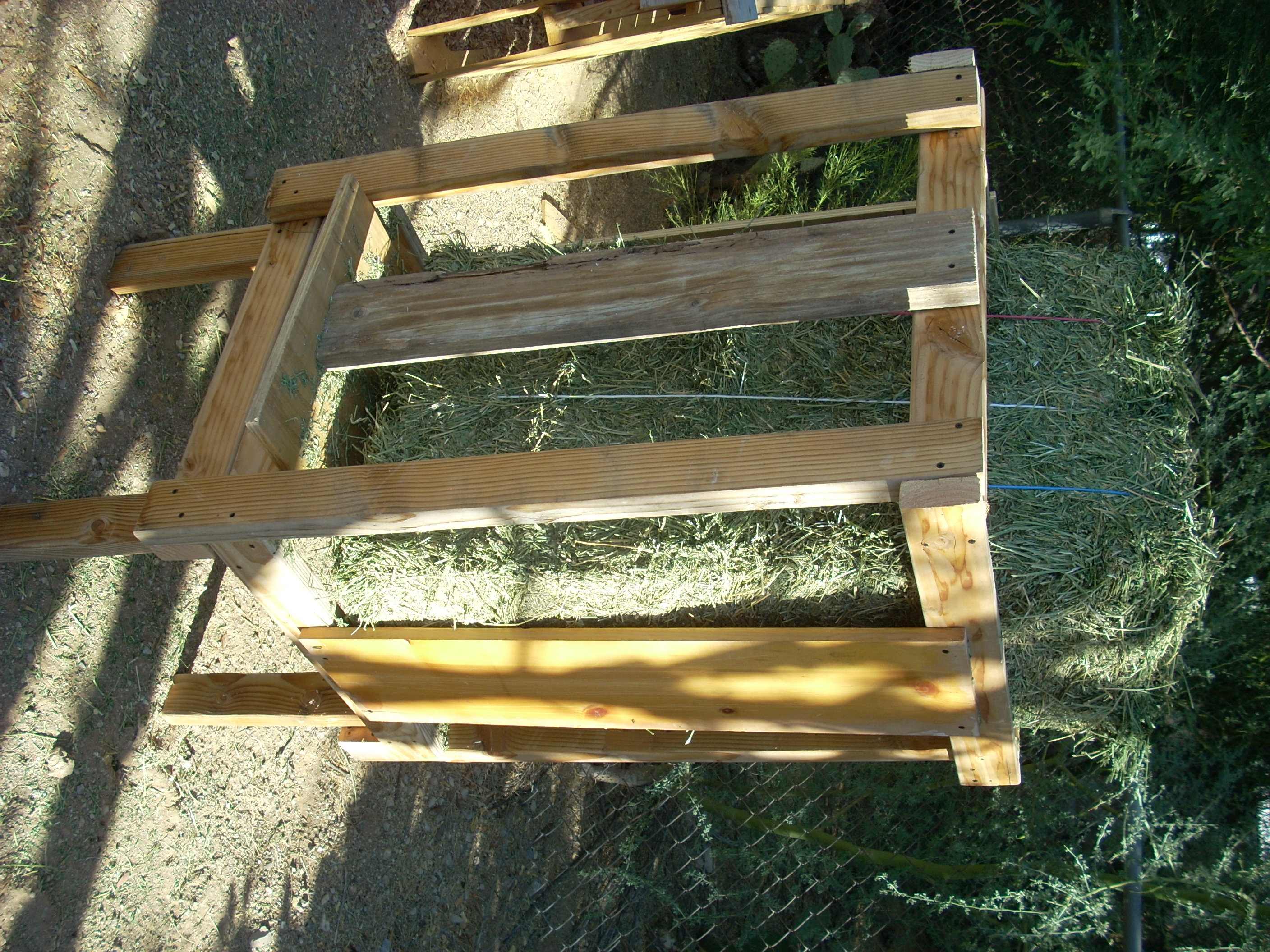 Hay Feeder Plans http://futuretribal.wordpress.com/2012/05/22/day-48-goat-feeders-and-garages/